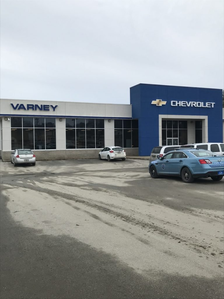 Police were called on Friday to the Varney Chevrolet dealership on Somerset Avenue in Pittsfield, where the body of a young woman was discovered in the trunk of a locked Chevrolet Malibu that had been towed earlier in the day from Walmart in Palmyra.