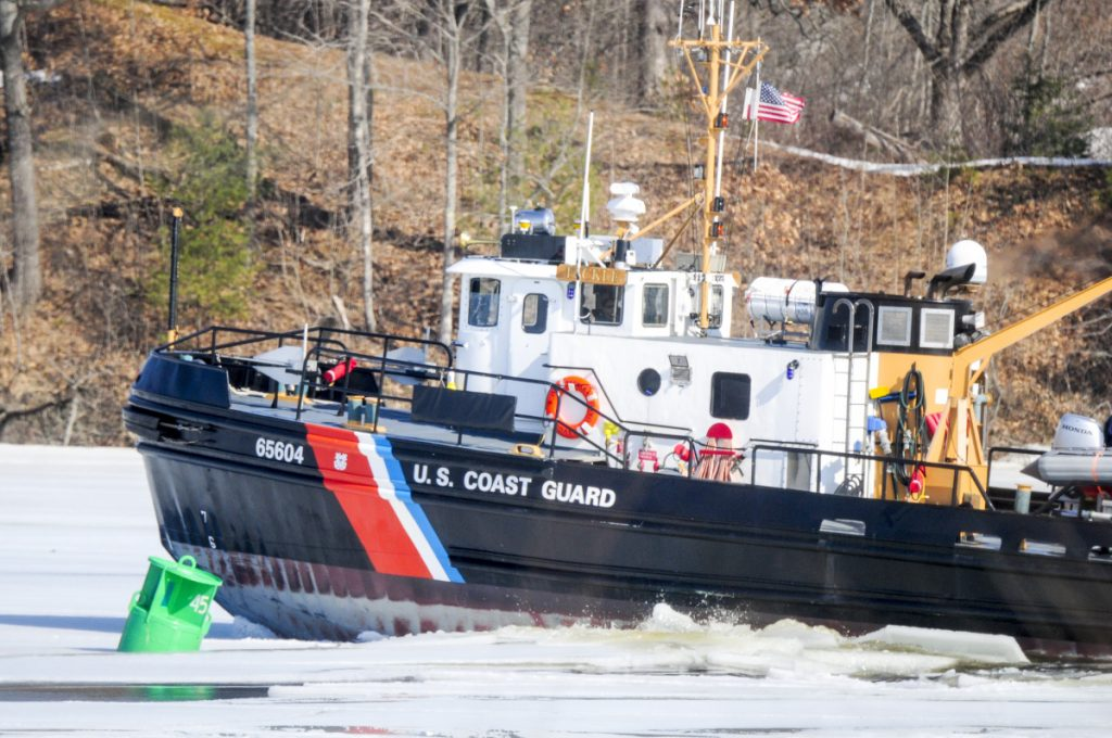 The USCGC Tackle breaks ice Thursday as it heads north on the Kennebec River between Pittston and Gardiner.
