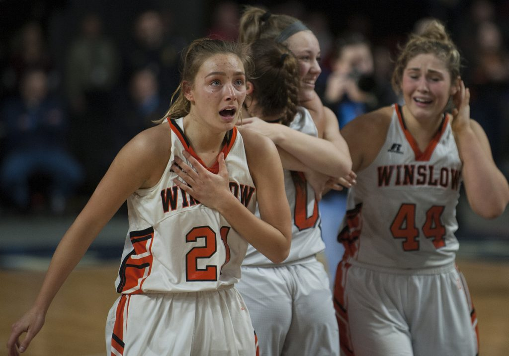 Winslow's Haley Ward looks to the scoreboard in the Cross Insurance Center in Bangor after the Black Raiders defeated Lake Region 43-29 in the Class B state championship game Friday night.