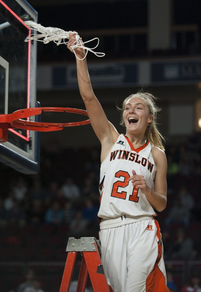 Winslow's Haley Ward swings a net after the Black Raiders defeated Lake Region 43-29 in the Class B Girls state championship game Friday at the Cross Insurance Center in Bangor.