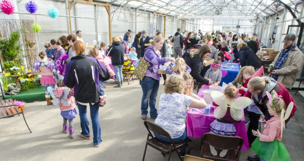 Adults help children make fairy arts-and-crafts projects Saturday during the Annual Fairy Festival at Longfellow's Greenhouses in Manchester.