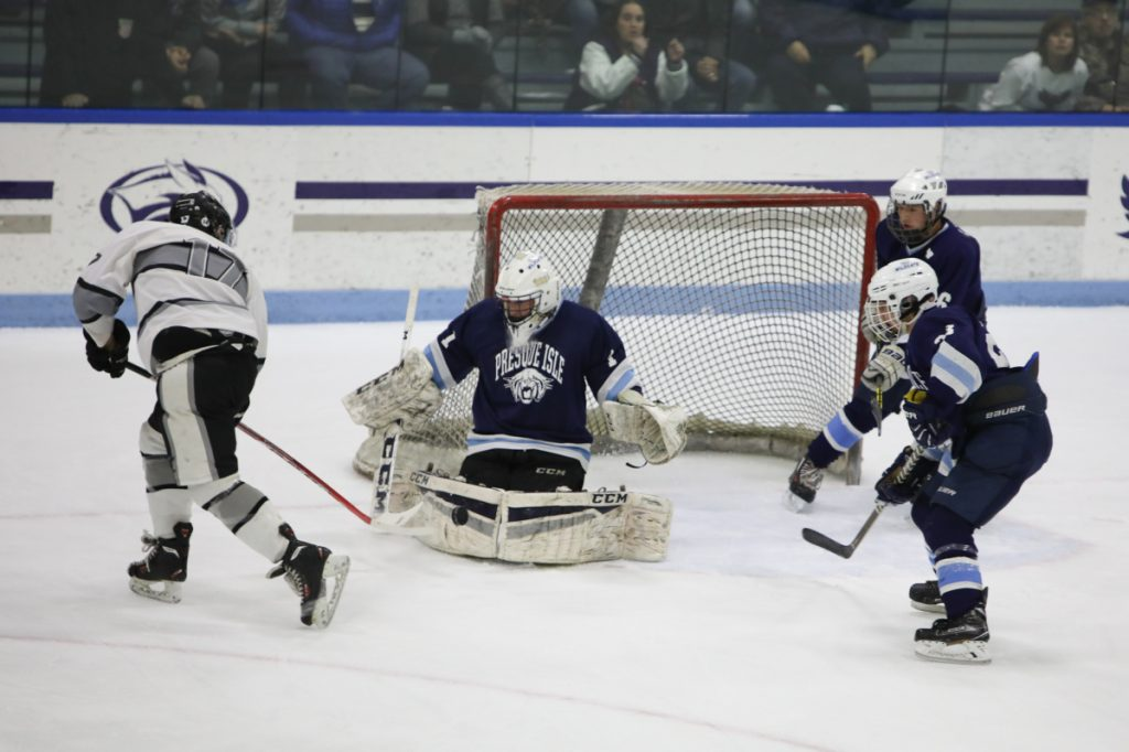 Kennebec's Cooper Hart (17) takes a shot on Presque Isle goalieAndre Daigle during a Class B North semifinal game Saturday at Colby College.