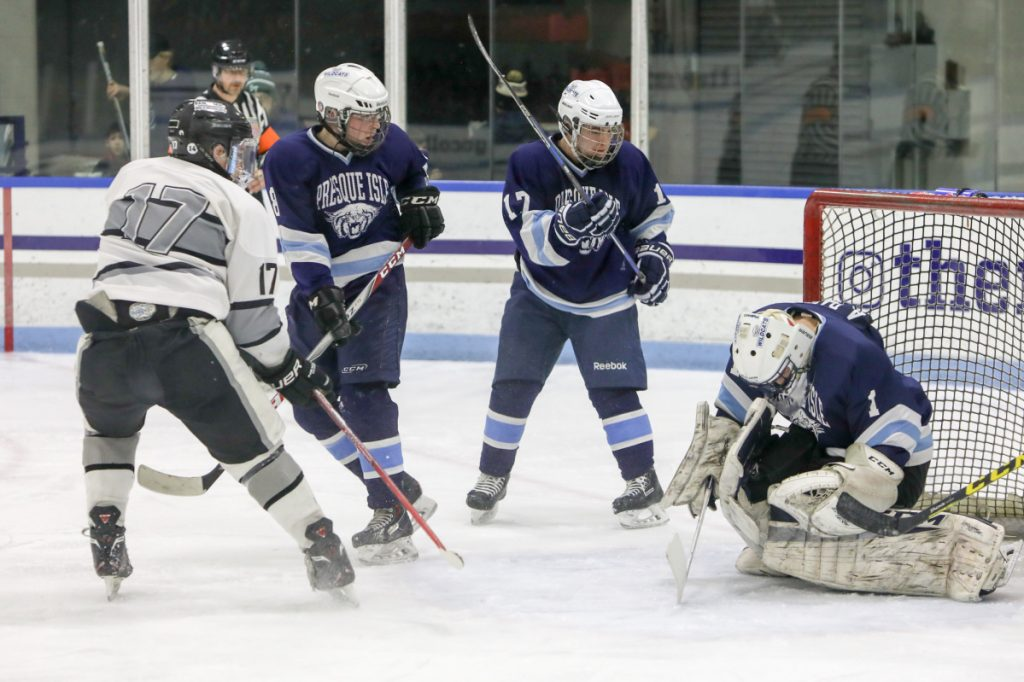 Kennebec's Cooper Hart (17) takes a shot on Presque Isle goalie Andre Daigle during a Class B North semifinal game Saturday at Colby College.