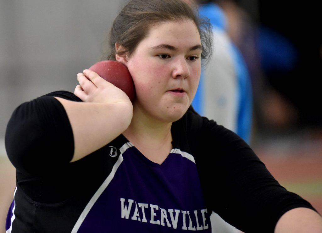 Waterville senior Sarah Cox, center, prepares to throw the shot put at a Feb. 3 Kennebec Valley Athletic Conference track and field meet at Bowdoin College in Brunswick. Cox finished 19th in the shot put at the New England championships on Saturday in Boston.