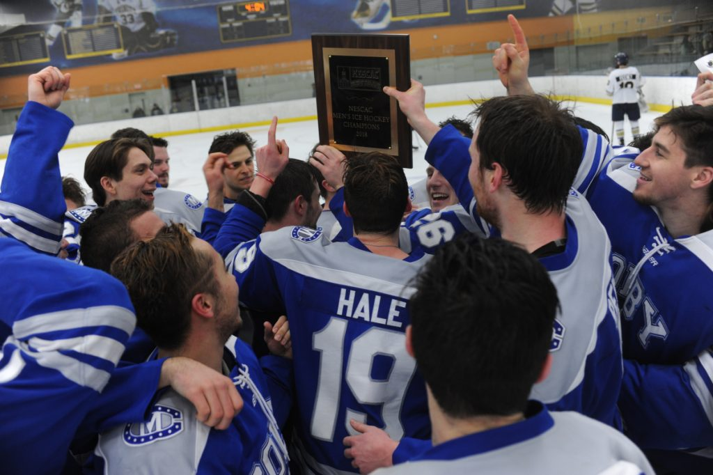 Contributed photo The Colby College hockey team celebrates its victory over Trinity in the New England Small College Athletic Conference championship game Sunday in Hartford, Connecticut.