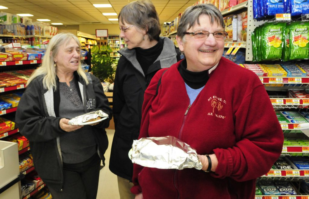 Solon Selectwomen, from left, Elaine Aloes, Sarah Davis and Mary Lou Ridley, showed up at the reopened Solon Corner Market to buy lunch and offer support to the new owners on March 23, 2016. Ridley retired this year after 20 years on the board.