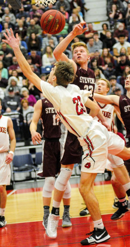 Staff photo by Joe Phelan   Hall-Dale's Ashtyn Abbott, bottom, and George Stevens' Max Mattson go for a rebound in the Class C state championship game Saturday at the Augusta Civic Center.