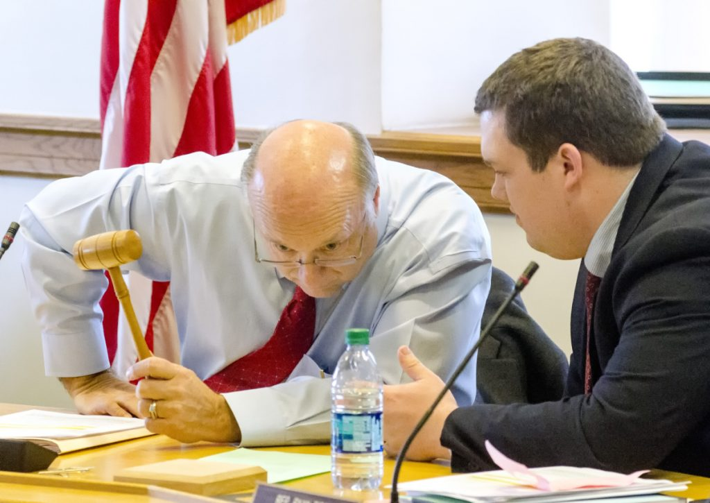 Taxation committee co-chairs Sen. Dana Dow, R-Waldoboro, left, and Rep. Ryan Tipping, D-Orono, confer before start of a  work session on L.D. 1781 on Tuesday at the State House in Augusta.