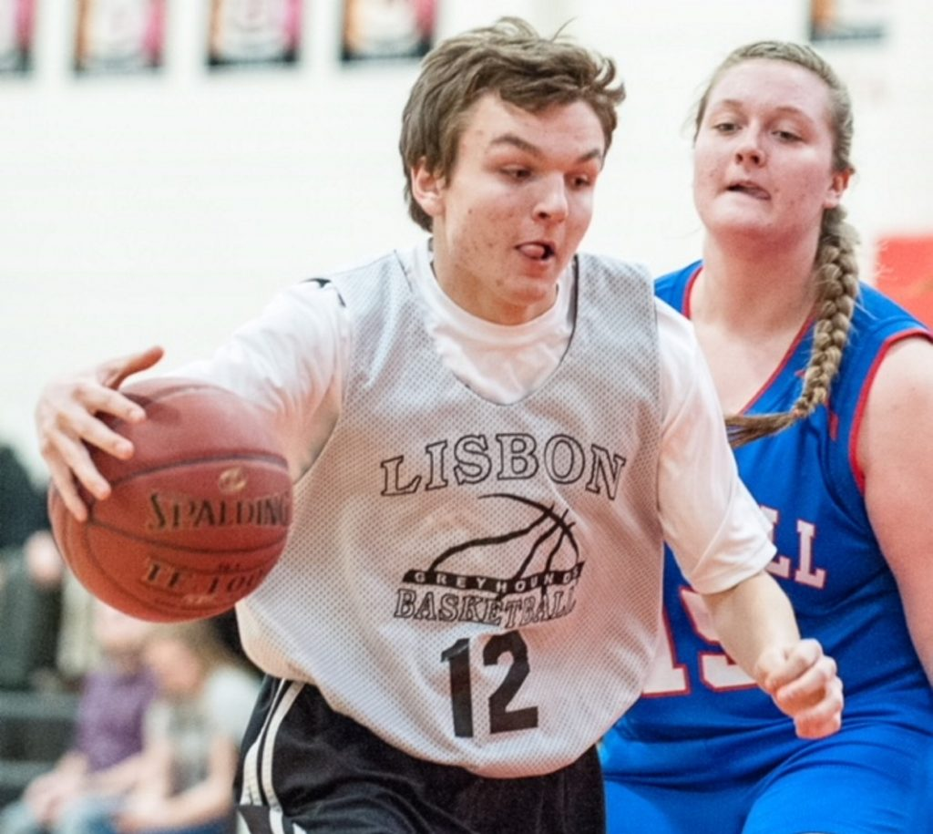 Lisbon's Nick Austin, left, dribbles up the court while being defended by Oak Hill's Alexis Harris during Tuesday's Unified basketball game in Lisbon.