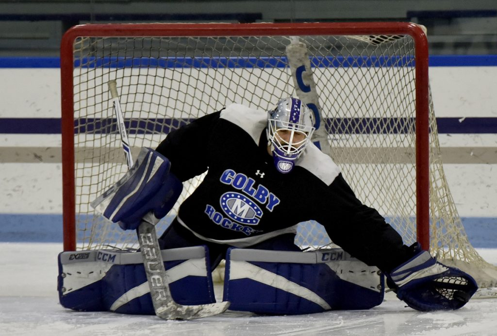 Colby goalie Sean Lawrence catches a puck in his gove during practice Tuesday in Waterville.