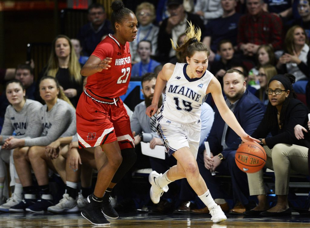 Maine's Dor Saar drives past Alexia Douglas of Hartford on Friday during the America East championship game in Bangor.