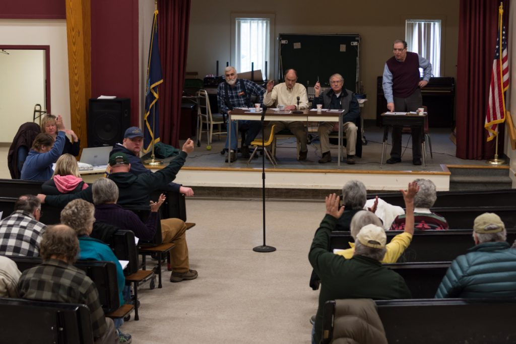 "Starks residents vote by a show of hands Saturday morning to adopt a proposed ""Local Food & Community Self Governance Ordinance"" at Town Meeting in Starks."
