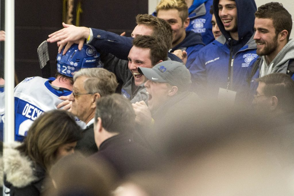 Colby College fans greet senior defenseman Michael Decker (2) the team leaves the ice at Harold Alfond Forum in Biddeford following the Mules' 4-2 win over the University of New England in the first round of the NCAA Division III hockey tournament Saturday night.