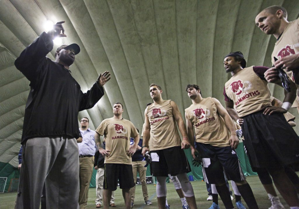Head coach James Fuller speaks to players at the conclusion of local tryouts Sunday for Maine's new indoor football team, the Mammoths, at Seacoast United of Topsham.