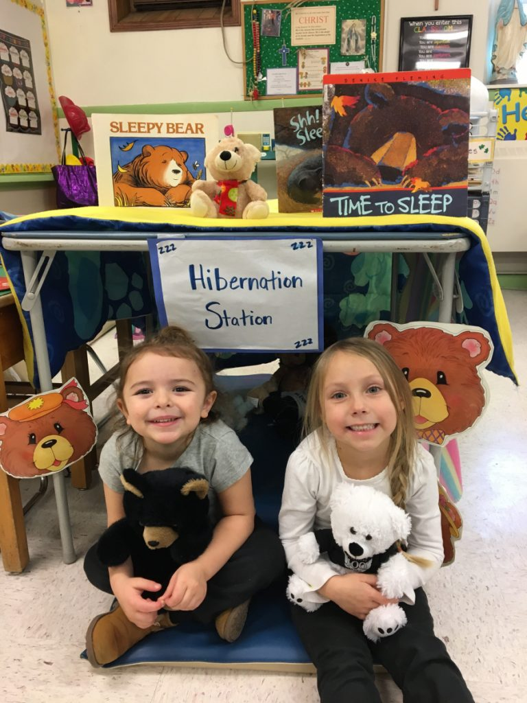 St. Dom's pre-kindergarten students recently studied hibernation and migration in their science units. Juliana Ramsey, left, and Norah Reeder take their turn in the hibernation station.