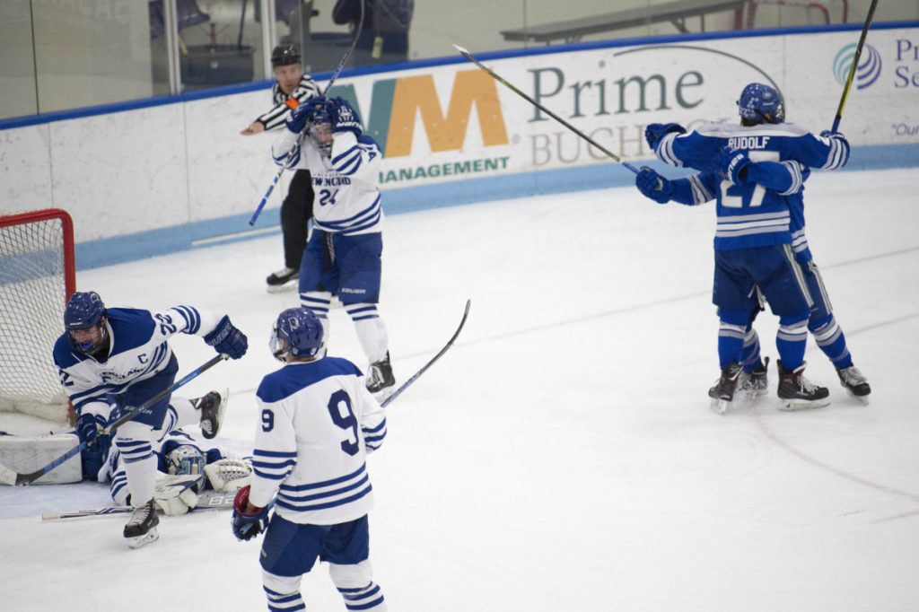 Colby forward Michael Rudolf, back right, celebrates his goal against University of New England in the second period of an NCAA Division III first round game last Saturday at the Alfond Forum in Biddeford.