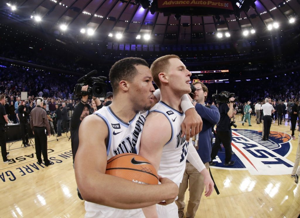 Villanova's Jalen Brunson, left, celebrates with Donte DiVincenzo after the team's game against Providence in the Big East men's tournament final Saturday in New York.
