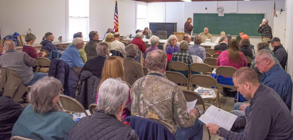 Rome residents gather for Saturday's Town Meeting, where a referendum about appropriating money to repave and reconstruct North Pond Road passed overwhelmingly.