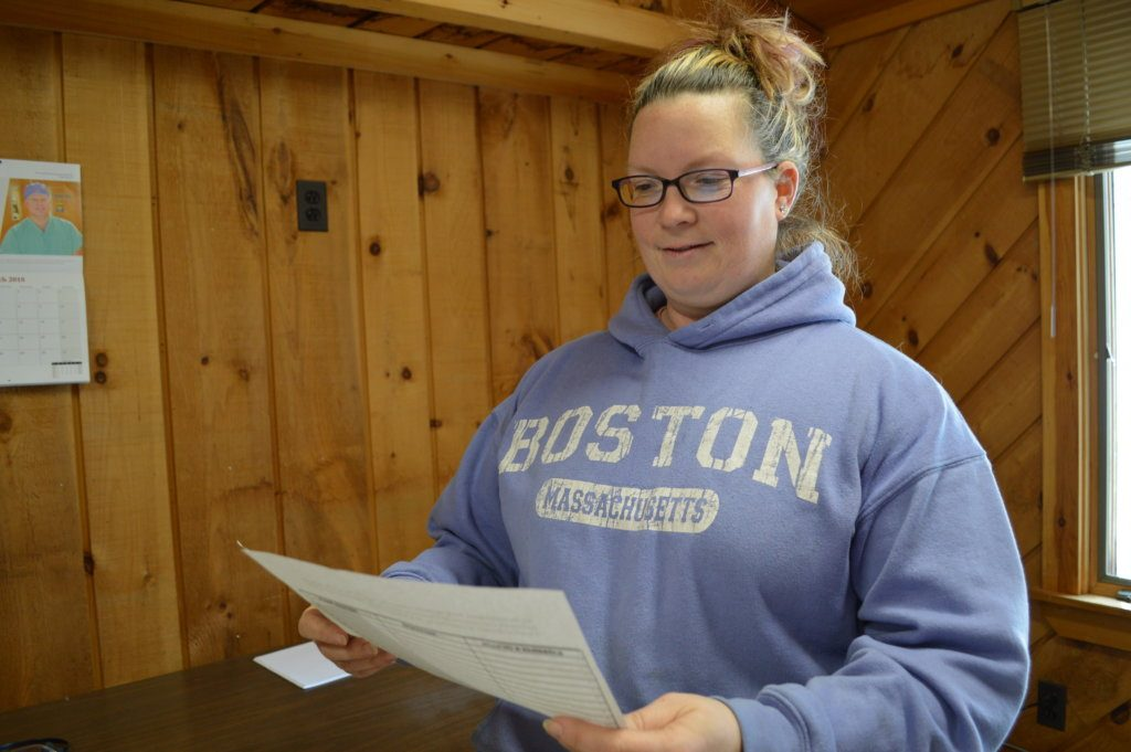 Tiffany Estabrook, of Chesterville, is working with others to collect voters' signatures on a petition asking the state commissioner of education to determine the reapportionment of the Regional School Unit 9 board of directors.