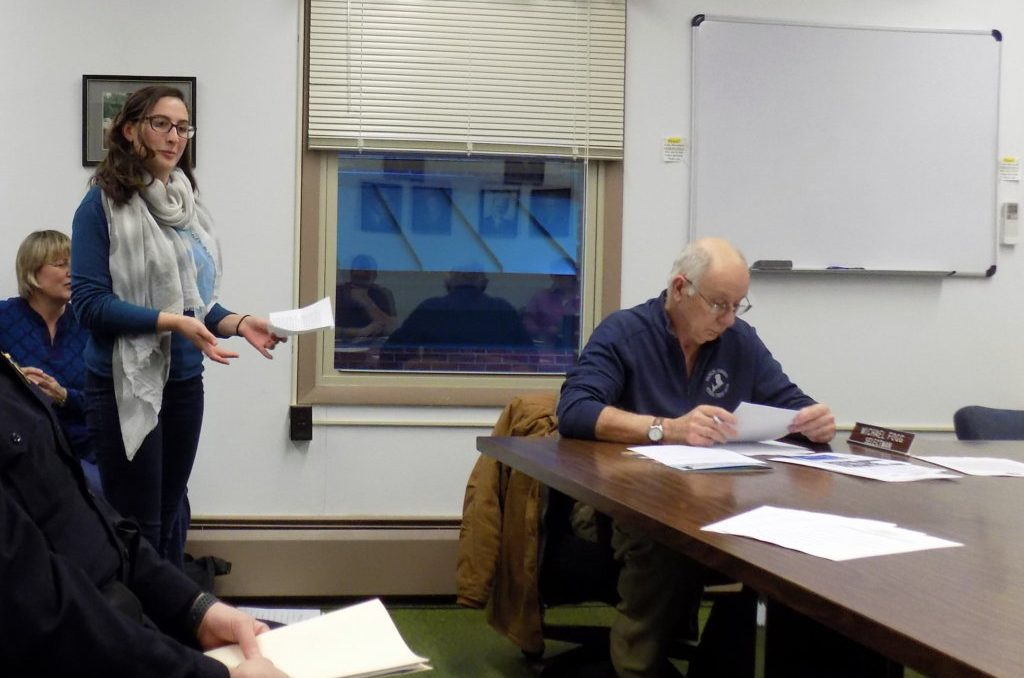 Mt. Blue High School senior River Lisius addresses the Farmington Board of Selectmen on Thursday night about using Meetinghouse Park for a student march. Selectman Michael Fogg is at right.