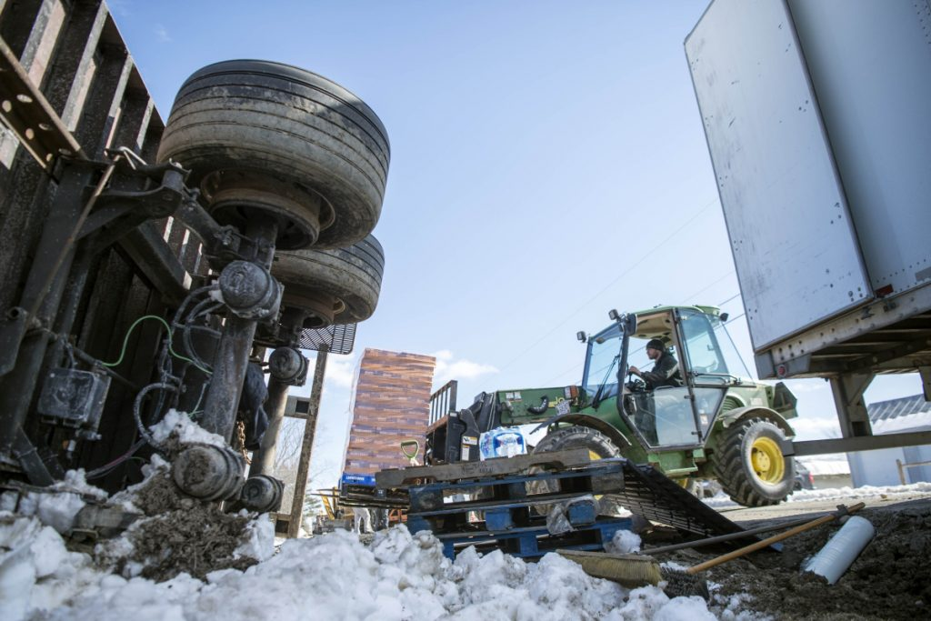 A tractor was employed to transfer a payload of beer from one tractor-trailer to another Friday after the first rolled over on Trafton Road in Waterville when it hit a soft shoulder.