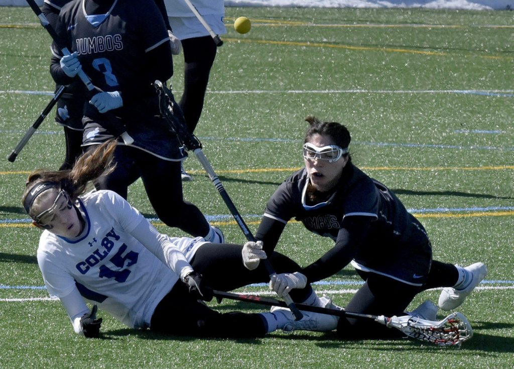 Colby's Melinda Edie, left, and Tufts' Margaret Chase fall after colliding during a game Sunday in Waterville.