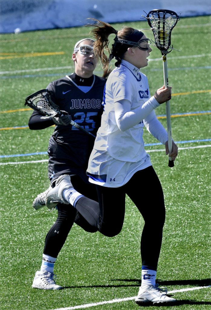 Colby's Merritt Davie takes the ball downfield as Caroline Nowak of Tufts pursues during a game Sunday in Waterville.