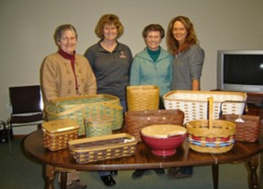 From left are Joan MacKenzie, Michaelyn Smith, Judy Johnson and Jill Mackenzie with basket that will be part of the basket bingo fundraiser set for March 30.