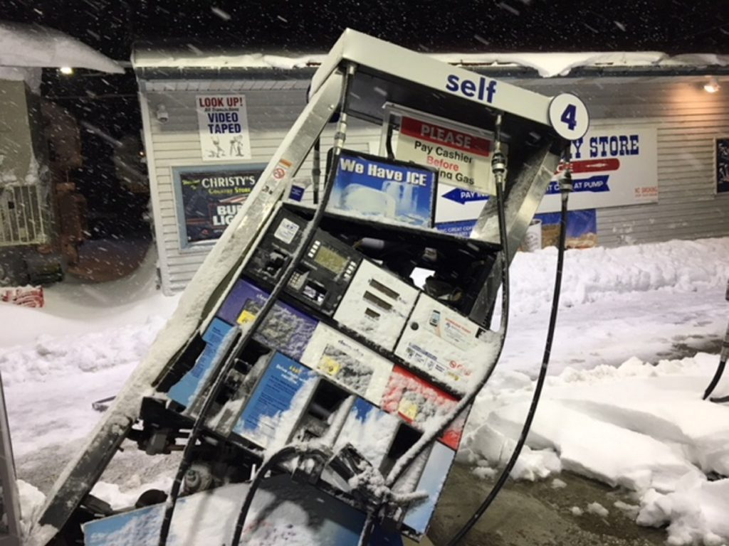 This fuel pump in front of Christy's Country Store in Belgrade was struck by a plow truck last week during a snowstorm. Efforts to clean up the estimated 1,800 gallons of spilled fuel are underway.