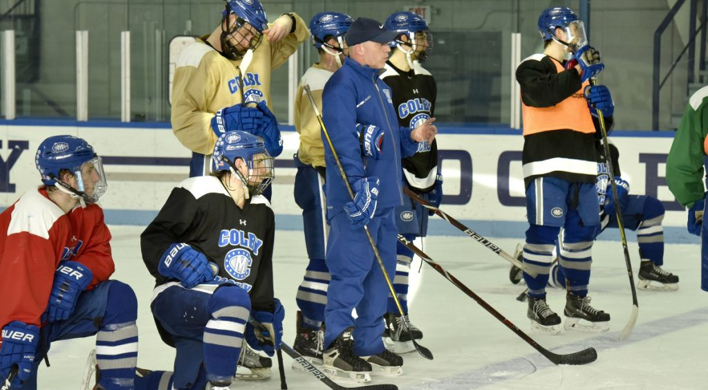 Colby College assistant hockey coach Mike Latendresse watches a drill during practice Tuesday in Waterville.