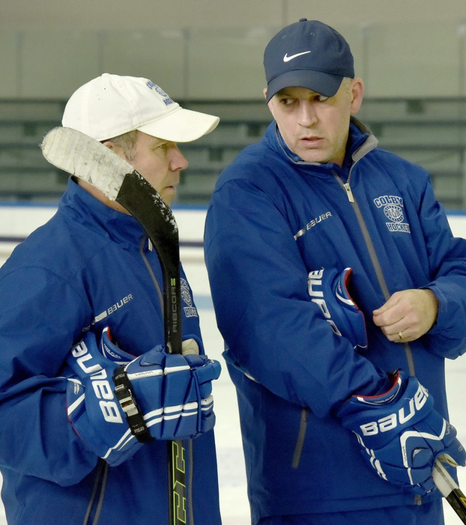 Colby College assistant hockey coach Mike Latendresse, right, confers with head coach Blaise MacDonald during practice Tuesday in Waterville.