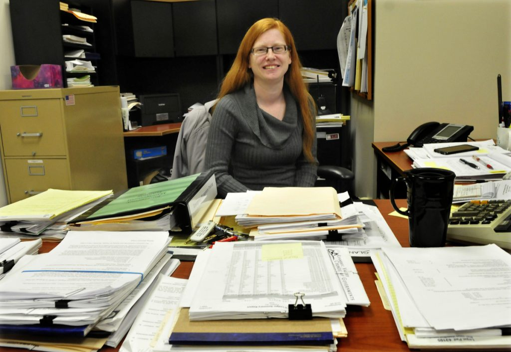 Skowhegan Town Manager Christine Almand, seen at her desk in the municipal building on Dec. 22, 2015, can't recall a time when no incumbents were running for re-election to a selectman's seat.