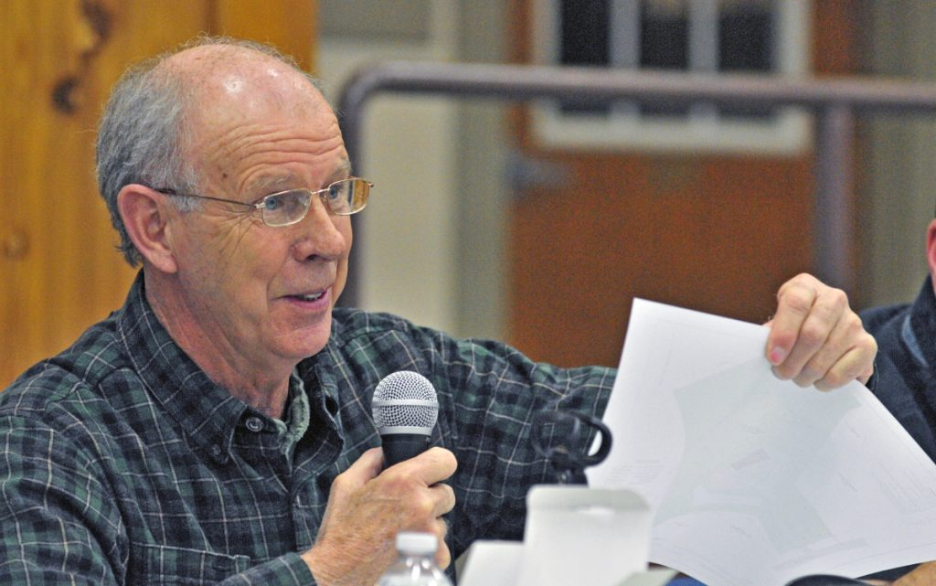 Former Belgrade Selectman Ernie Rice said town officials violated his free speech rights by temporarily removing a sign opposing a town librarian ballot question.