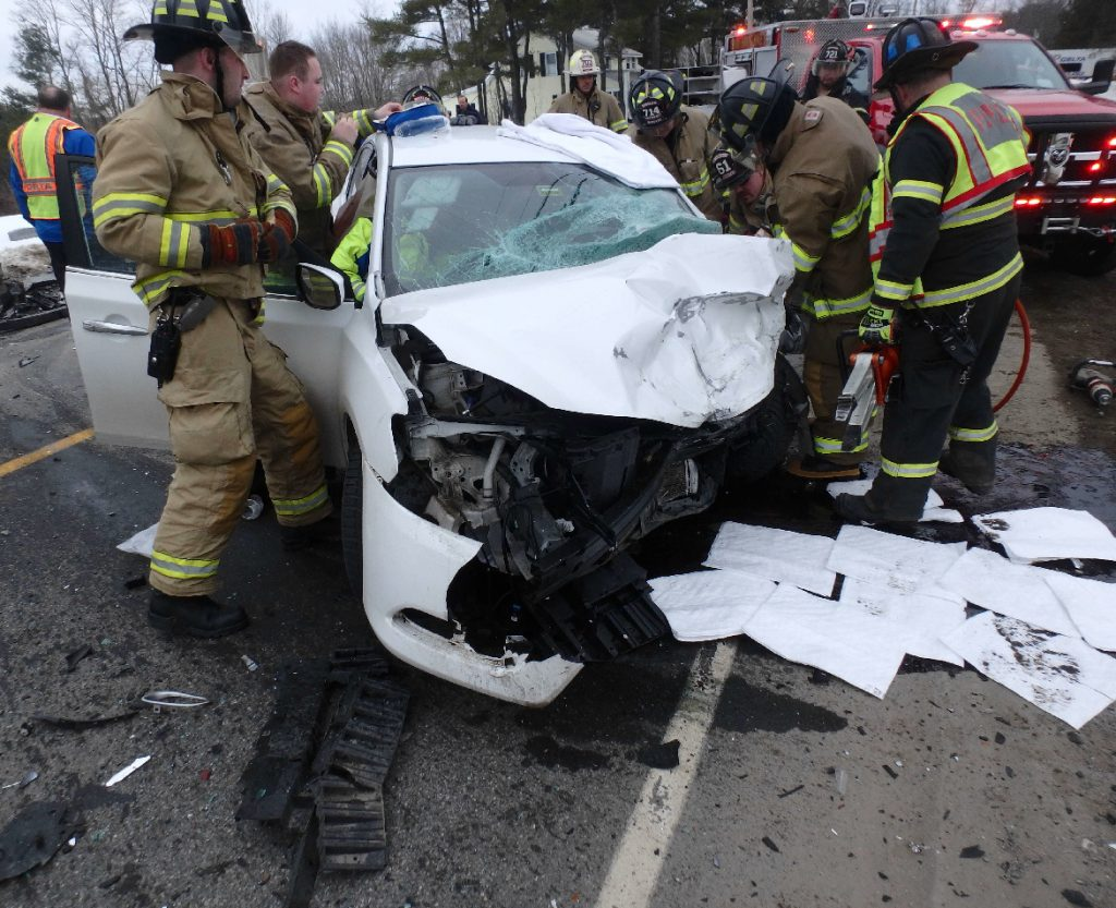 A crew from Winslow Fire and Rescue works to extricate Amos Christiansen on Wednesday evening from his 2014 Nissan Sentra after a head-on collision on Augusta Road in Winslow. Police say Christiansen might have fallen asleep at the wheel, causing him to cross the center lane into oncoming traffic.
