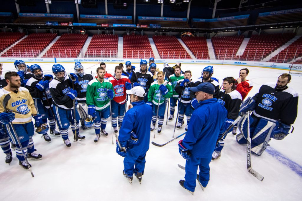 Colby men's hockey coach Blaise MacDonald, front left, talks to his team during practice Thursday afternoon at Herb Brooks Arena in Lake Placid, New York. The Mules will play St. Norbert College in an NCAA Division III Frozen Four game at 6:30 p.m. Friday. At right is assistant coach Mike Latendresse, a Winslow resident and former Messalonskee High School hockey coach.