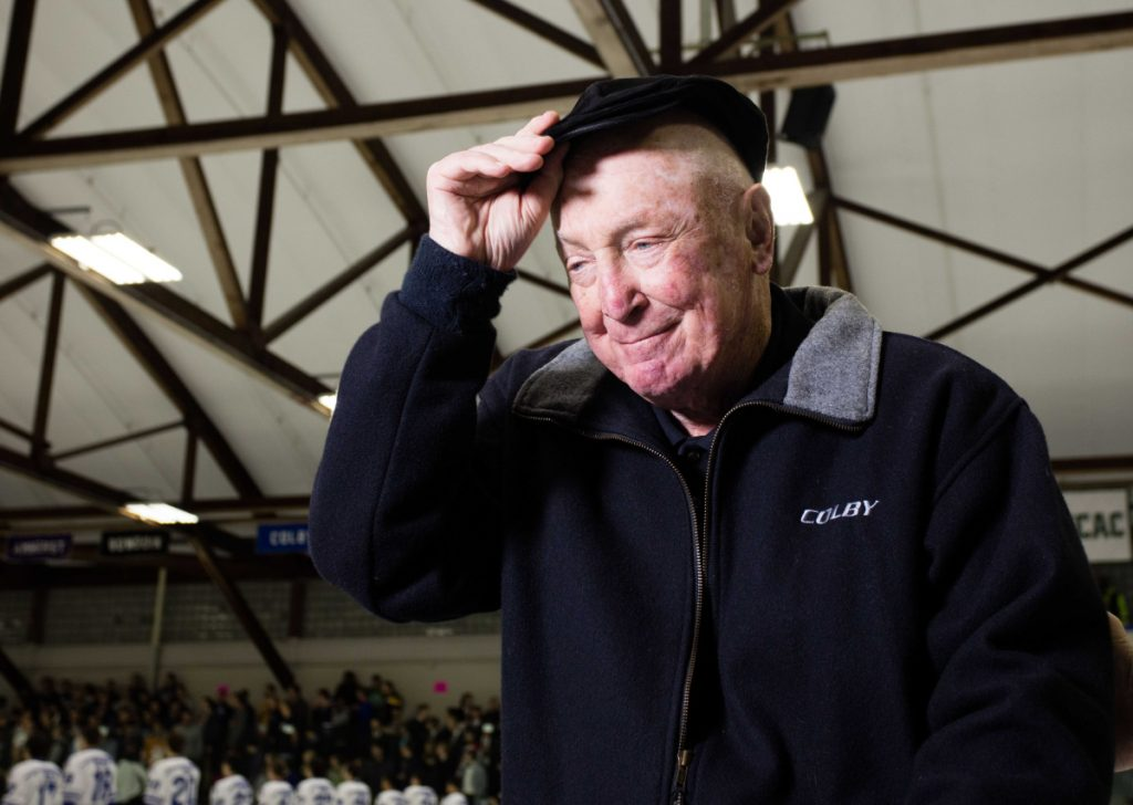 Longtime Colby College men's hockey coach Jack Kelley tips his cap before an Oct. 29, 2015, game against Bowdoin College inside Alfond Rink in Waterville. Kelley, 90, lives in Venice, Florida, but still follows the Mules closely.