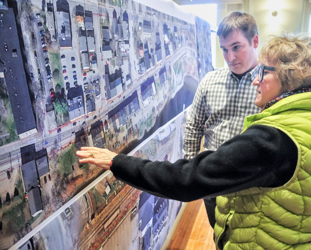 Dawn Gallagher, front, asks Cody Jean, project superintendent for Sargent Corp., a question during an open house Thursday in Hallowell City Hall about the upcoming Water Street construction project.