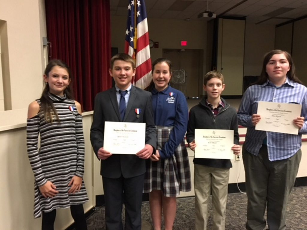 The DAR American History Essay contest winners, from left, are Ava Nadeau, Parker Reynolds and Georgiana Davidson, who placed first in their grade; and Teddy Wagner and Ethan Barrett, who placed second in their grade. Kameron Douin, who also placed second in his grade, was absent.