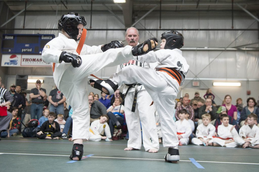 Staff photo by Michael G. Seamans   Dylan Lomas, left, and Vincent Young, right, spar at the Battle of Maine Martial Arts tournament Saturday at Thomas College in Waterville.