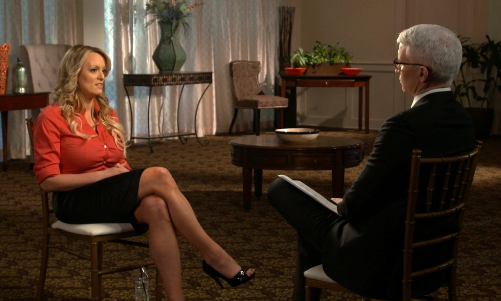 "This image released by CBS News shows Stormy Daniels, left, during an interview with Anderson Cooper which will air on Sunday on ""60 Minutes."""