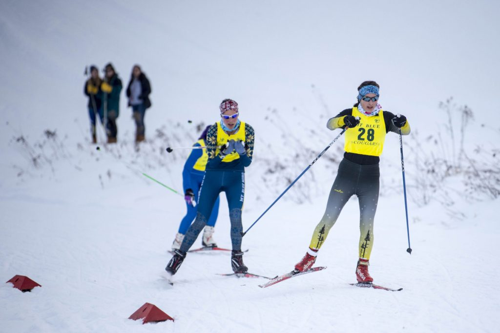 Staff file photo by Michael G. Seamans   Maranacook's Laura Parent (28) leads Mt Blue's Meg Charles, left, and Morse's Jenny Wilbraham in the Cougar Soft 7 race earlier this winter at Titcomb Mountain in Farmington.
