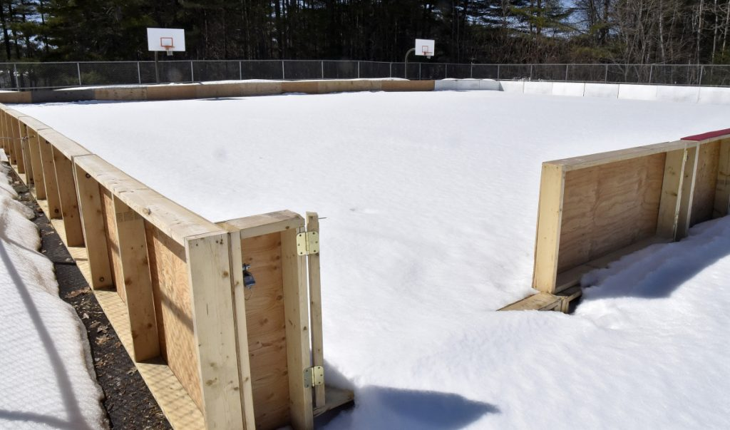 The relocated ice skating rink in Skowhegan is covered with snow Monday at the new location near the town recreation center. A group of locals is concerned with the new ice rink location after it was moved from the Skowhegan Fairgrounds.