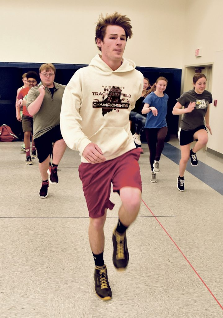 Erskine track and track runner Chris Weymouth does exercises with the team Monday in South China. It was the first day of spring practices.