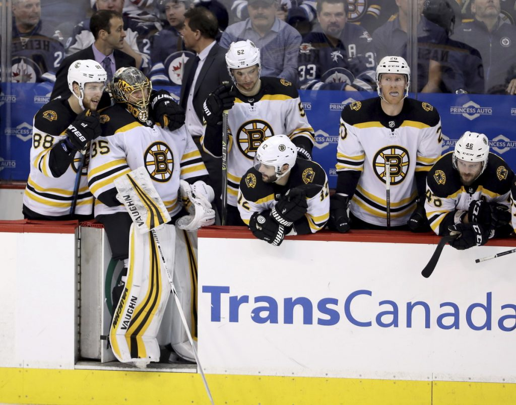 Boston forward David Pastrnak (88) and goaltender Anton Khudobin (35) stand on the Bruins bench during the shootout against the Winnipeg Jets on Tuesday.