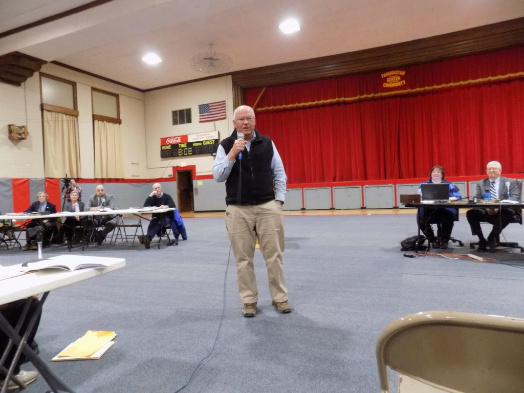 Owner and resident Colon Durrell, who spent more than $50,000 to pave the road in Farmington's Kashke Terraces development, says the road and development meet the town's Comprehensive Plan and Zoning Ordinance. Voters approved the road as a town way at Monday's Town Meeting.