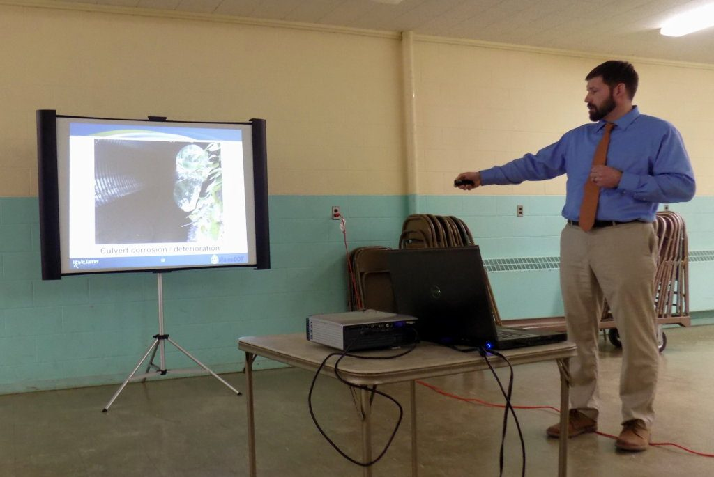 Project Manager Aron Lachance of Hoyle, Tanner & Associates of Portsmouth, New Hampshire, shows slides Thursday night of the deteriorated Dutch Gap Bridge in Chesterville. The company has designed a new bridge over Little Norridgewock Stream.