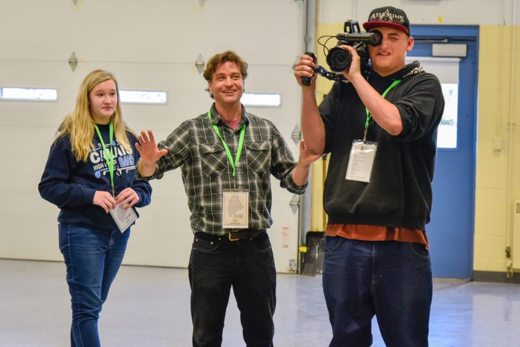 Filmmaker Brett Plymale, of Kennebunkport, center, coaches Randy Hubbard, right, 17, of Waterville, on Saturday in how to operate a camera. They are joined by Cassie Carr, 13, of Calais, at the Maine Student Film & Video Conference in Waterville.