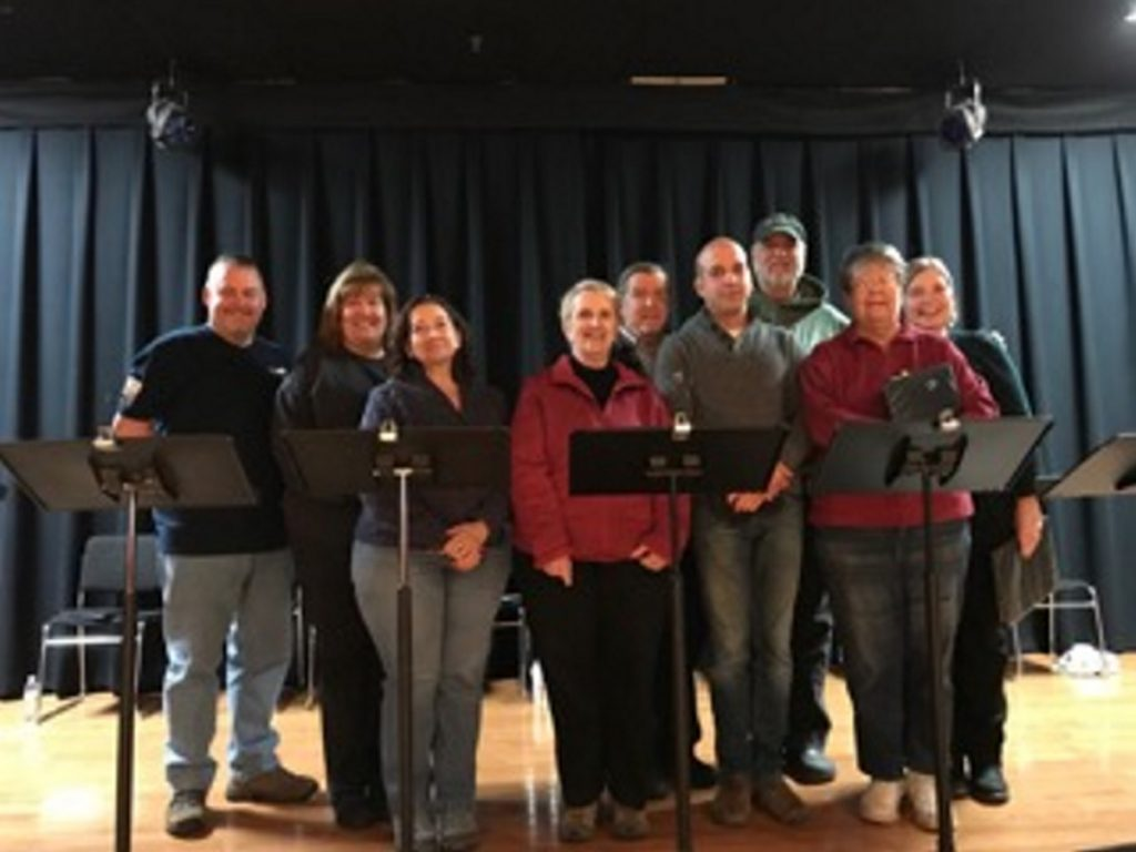 "Cast members of ""The World of Carl Sandburg,"" from left, are Arthur Bourget, Kathy Kauffman, Cindy Turcotte, Ginger Smith, Frank Omar, David Moisan, Bill Haley, Christine Heckman, and Connie LaFlamme."