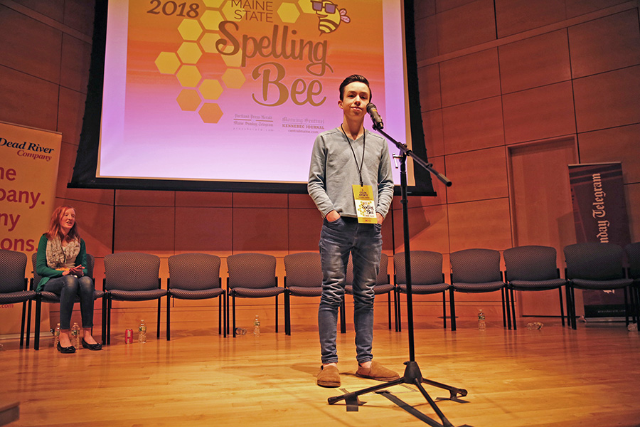 "Colin Aponte, an eighth-grader at Downeast Homeschool Coop, reacts after successfully spelling ""crescendo"" to win the 2018 Maine State Spelling Bee on Saturday at University of Southern Maine. Second place finisher was Moriah Reusch, left, a seventh-grader from Mt. Blue Middle School."