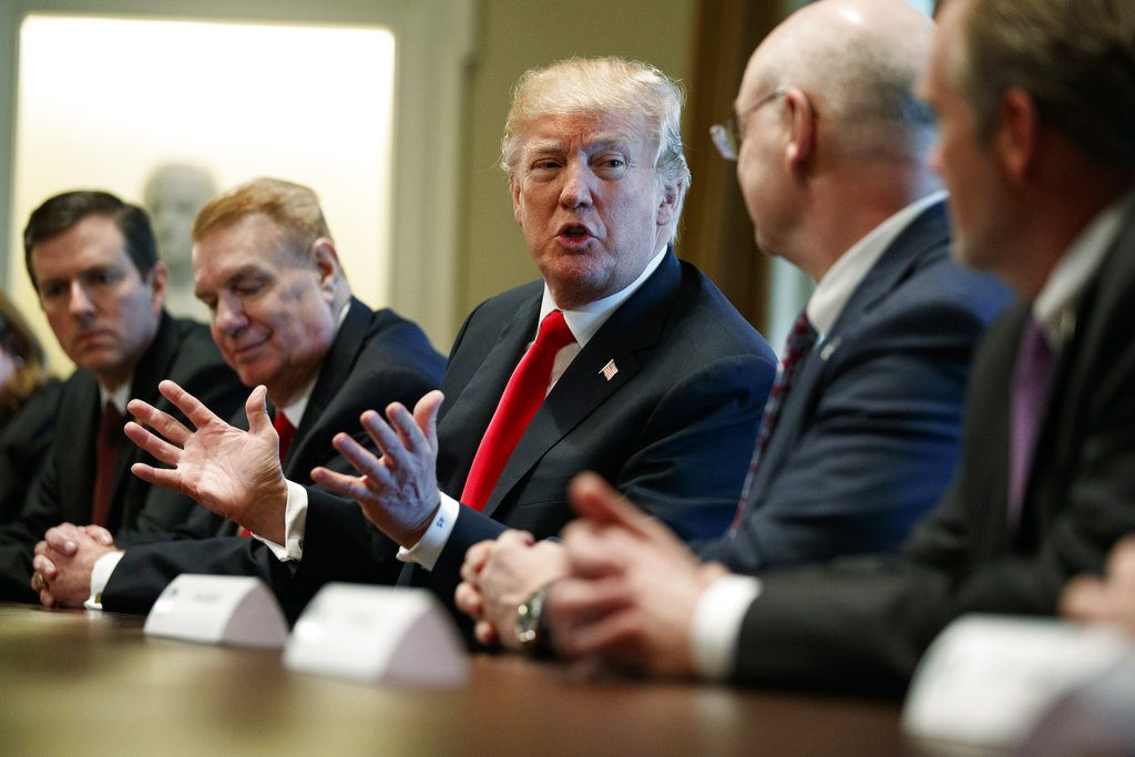President Trump speaks to steel and aluminum executives in the Cabinet Room of the White House, Thursday. From left, Roger Newport of AK Steel, John Ferriola of Nucor, Trump, Dave Burritt of U.S. Steel Corp., and Tim Timkin of Timken Steel.